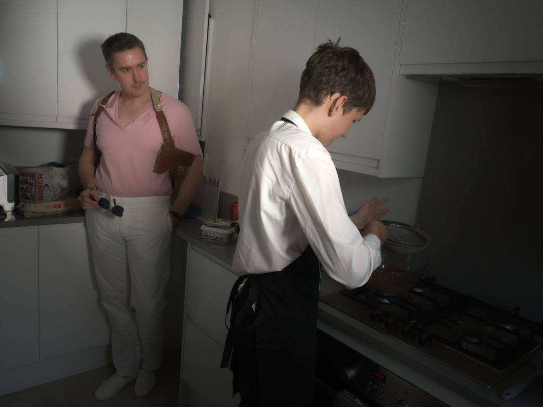 Laurence as Sonny Crockett from Miami Vice while Tom cooks